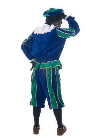 zwarte piet: Zwarte Piet is looking away. Zwarte Piet is a Dutch tradition during Sinterklaas, which is celebrated in December the fifth. Stock Photo