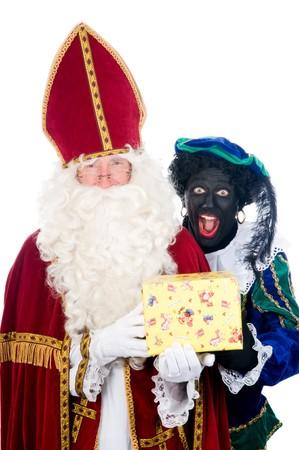 Saint Nicholas and his helper Stock Photo - 8124643