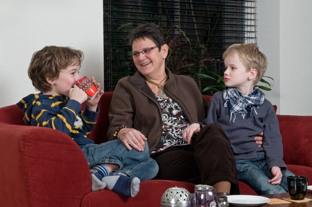 cosiness: Family with two brothers and grandma in a livingroom