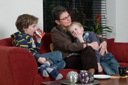 Family with two brothers and grandma in a livingroom photo