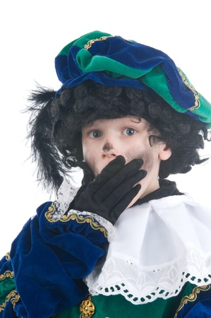zwarte: Young child playing Zwarte Piet (Black Pete), this is a Dutch tradition when Sinterklaas is celebrated in december. Stock Photo