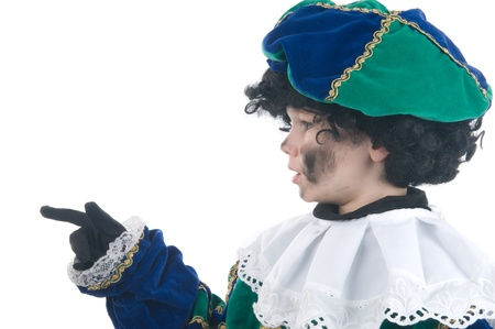 black pete: Young child playing Zwarte Piet (Black Pete), this is a Dutch tradition when Sinterklaas is celebrated in december. Stock Photo