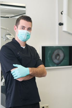 Portrait of a dentist in his dental practice Stock Photo - 12005209