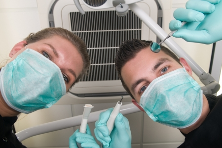 Picture of the dentist, as seen from the patient's point of view, lying in the chair Stock Photo - 12005512