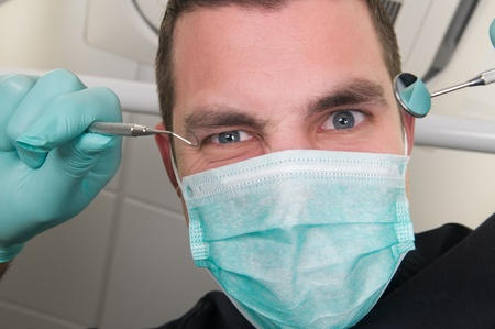 Picture of the dentist, as seen from the patient's point of view, lying in the chair photo