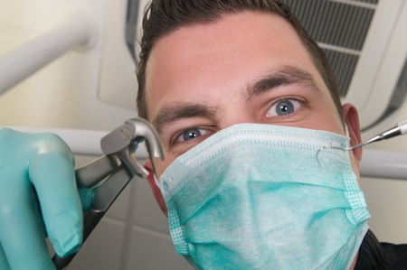 Picture of the dentist, as seen from the patients point of view, lying in the chair photo