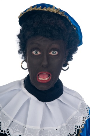 Zwarte Piet is a Dutch tradition during Sinterklaas, which is celebrated in December the fifth. Stock Photo - 13218650
