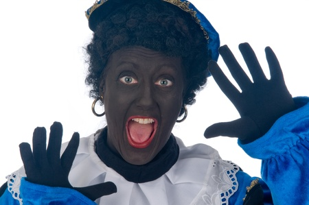Zwarte Piet is a Dutch tradition during Sinterklaas, which is celebrated in December the fifth. Stock Photo - 13218656