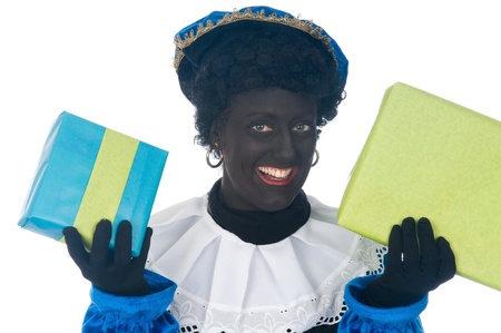 Zwarte Piet is a Dutch tradition during Sinterklaas, which is celebrated in December the fifth. Stock Photo - 13218632
