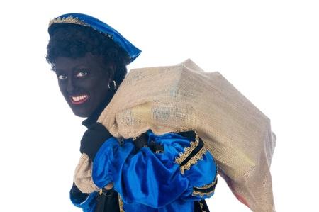 zak: Zwarte Piet is a Dutch tradition during Sinterklaas, which is celebrated in December the fifth.