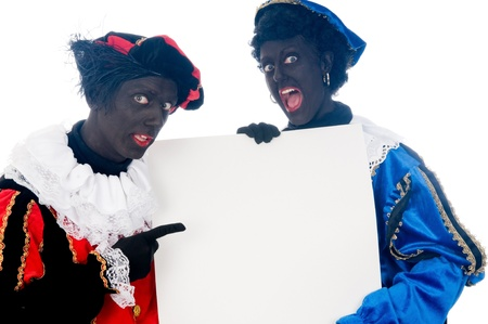 Zwarte Piet is a Dutch tradition during Sinterklaas, which is celebrated in December the fifth. Stock Photo - 13218633