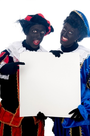 Zwarte Piet is a Dutch tradition during Sinterklaas, which is celebrated in December the fifth. Stock Photo - 13218631