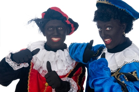 Zwarte Piet is a Dutch tradition during Sinterklaas, which is celebrated in December the fifth. Stock Photo - 13218660