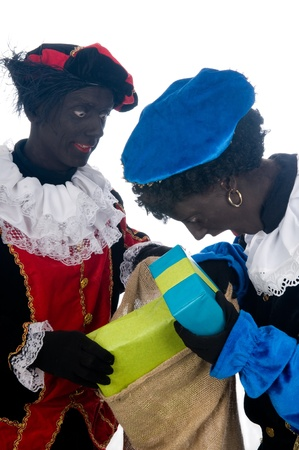 Zwarte Piet is a Dutch tradition during Sinterklaas, which is celebrated in December the fifth. Stock Photo - 13218662