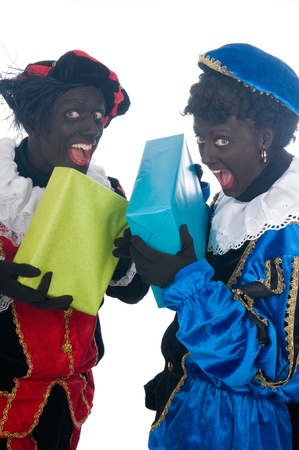 Zwarte Piet is a Dutch tradition during Sinterklaas, which is celebrated in December the fifth. Stock Photo - 13218661