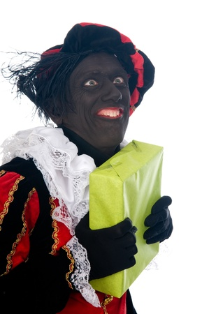 Zwarte Piet is a Dutch tradition during Sinterklaas, which is celebrated in December the fifth. Stock Photo - 13218638