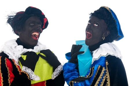 Zwarte Piet is a Dutch tradition during Sinterklaas, which is celebrated in December the fifth. Stock Photo - 13218647