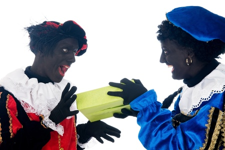 Zwarte Piet is a Dutch tradition during Sinterklaas, which is celebrated in December the fifth. Stock Photo - 13218643