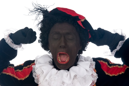 Zwarte Piet is a Dutch tradition during Sinterklaas, which is celebrated in December the fifth. Stock Photo - 13218641