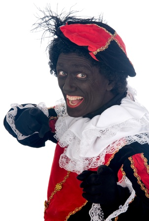 Zwarte Piet is a Dutch tradition during Sinterklaas, which is celebrated in December the fifth. Stock Photo - 13218646