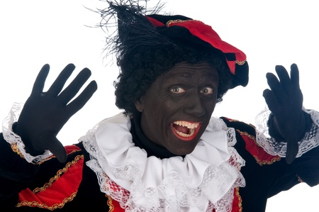 Zwarte Piet is a Dutch tradition during Sinterklaas, which is celebrated in December the fifth. Stock Photo - 13218644