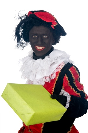 Zwarte Piet is a Dutch tradition during Sinterklaas, which is celebrated in December the fifth. Stock Photo - 13218630