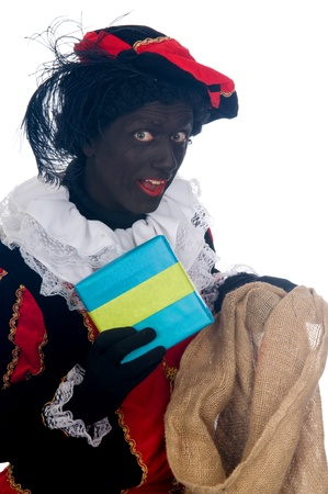 Zwarte Piet is a Dutch tradition during Sinterklaas, which is celebrated in December the fifth. Stock Photo - 13218659