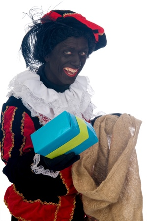 Zwarte Piet is a Dutch tradition during Sinterklaas, which is celebrated in December the fifth. Stock Photo - 13218627