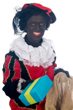 Zwarte Piet is a Dutch tradition during Sinterklaas, which is celebrated in December the fifth. Stock Photo - 13218658