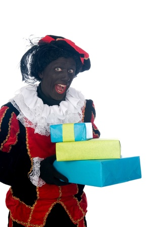 Zwarte Piet is a Dutch tradition during Sinterklaas, which is celebrated in December the fifth. Stock Photo - 13218624