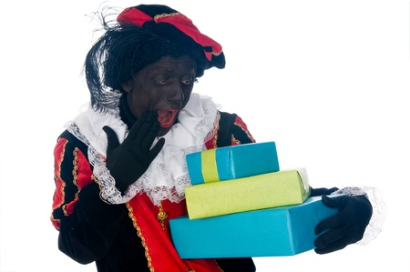 Zwarte Piet is a Dutch tradition during Sinterklaas, which is celebrated in December the fifth. Stock Photo - 13218639