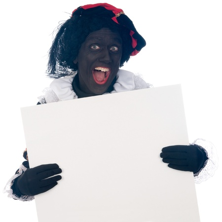 Zwarte Piet is a Dutch tradition during Sinterklaas, which is celebrated in December the fifth. Stock Photo - 13218621