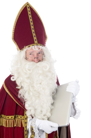 nicolas: Sinterklaas using a laptop in stead of his book