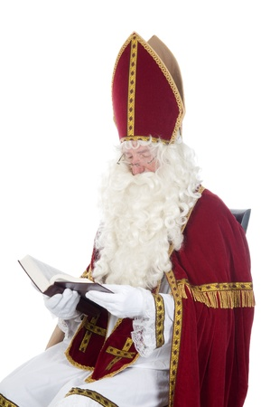 Sinterklaas is reading in his book photo