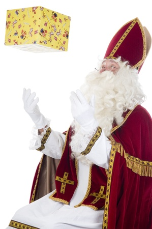 Sinterklaas and a present Stock Photo - 16036125