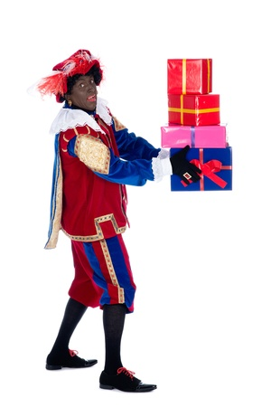 black pete: Zwarte Piet is a character, part of a  Dutch tradition called Sinterklaas, which is celebrated at December the fifth. Stock Photo