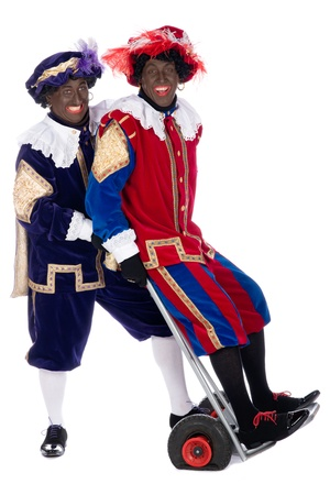 piet: Zwarte Piet is a character, part of a  Dutch tradition called Sinterklaas, which is celebrated at December the fifth. Stock Photo