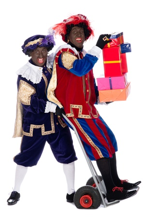 zwarte piet: Zwarte Piet is a character, part of a  Dutch tradition called Sinterklaas, which is celebrated at December the fifth. Stock Photo