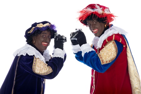 zwarte: Zwarte Piet is a character, part of a  Dutch tradition called Sinterklaas, which is celebrated at December the fifth. Stock Photo