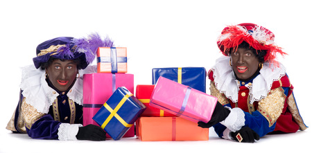 Zwarte Piet is a character, part of a  Dutch tradition called  Sinterklaas , which is celebrated at December the fifth  Stock Photo - 22248487