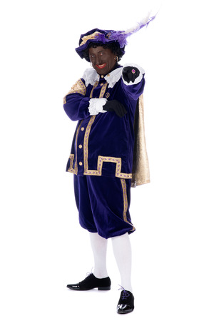 Zwarte Piet is a character, part of a  Dutch tradition called  Sinterklaas , which is celebrated at December the fifth Stock Photo - 22248492