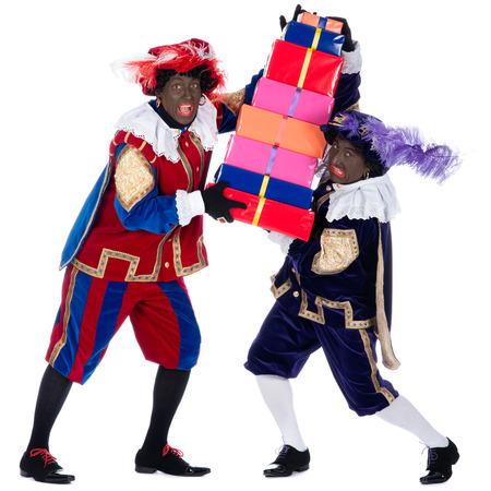 Zwarte Пит это символ, часть голландской традиции называется Sinterklaas, который отмечается на декабрь пятый Фото со стока
