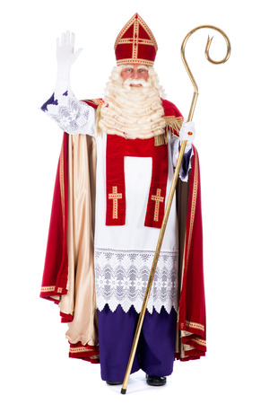 Portrait of Santa Claus with staff, on a white  Фото со стока
