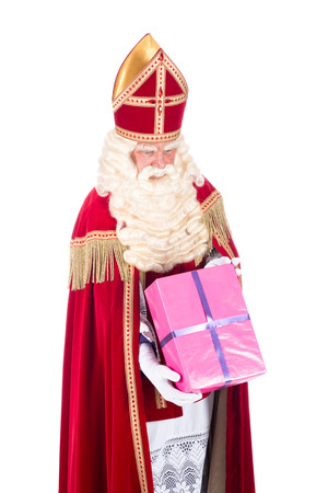 studioshoot: Santa Claus giving a present to a child, on a white