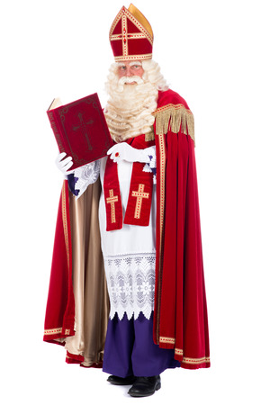 studioshoot: Portrait of Santa Claus with his book, on a white