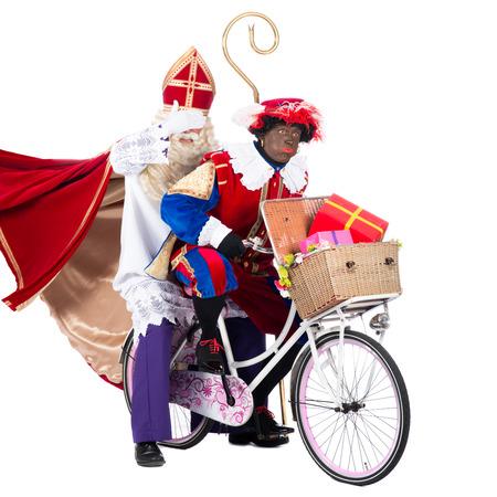 Zwarte Пит в спешке получать подарки детям во времени Фото со стока