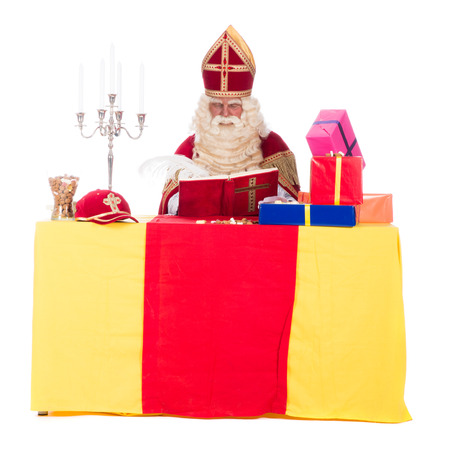 studioshoot: Santa Claus is working at his desk, at a white