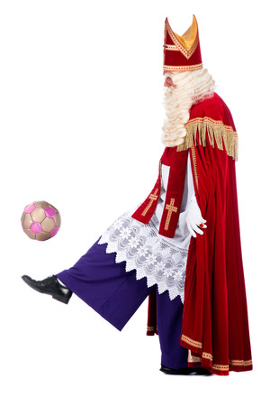 studioshoot: Santa Claus playing soccer, on a white