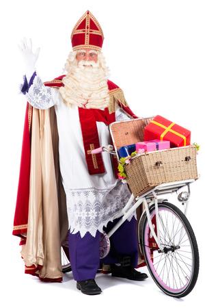 Санта-Клаус на велосипеде, собирается принести подарки детям