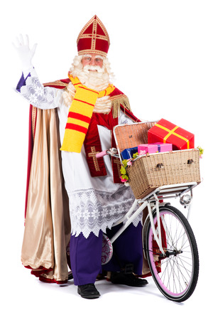 Sinterklaas on a bike, going to bring presents to the children Stockfoto